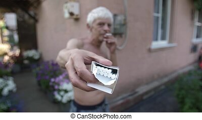Mature man offers a cigarette