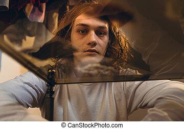 Addicted teenage boy experiencing psychotropic effects