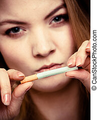 Addiction. Girl breaking cigarette. Quit smoking. - ...
