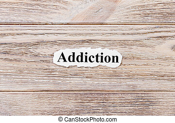 Addiction of the word on paper. concept. Words of Addiction on a wooden background