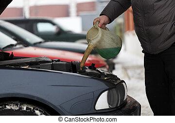 Adding antifreeze near garage