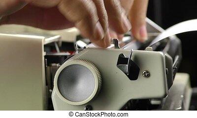 Adding paper to typewriter