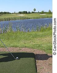 Addressing golfball on a par three