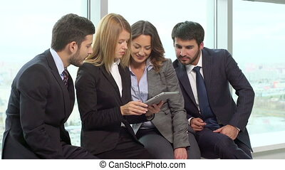 Adequate Solution - Business people combining efforts while...