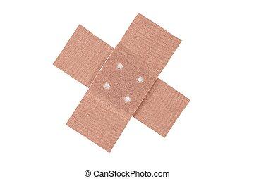 Adhesive bandage cross on white