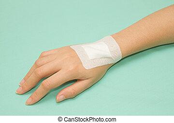 Adhesive Healing plaster on hand