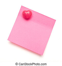 Dark pink self adhesive post it note with heart shape push pin on white.