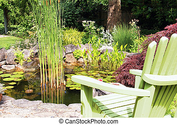 Adirondack chair at the pond