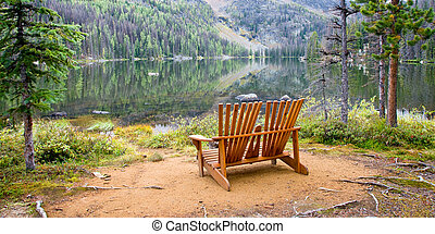 Adirondack Chairs - A set of Adirondack chairs sit along the...