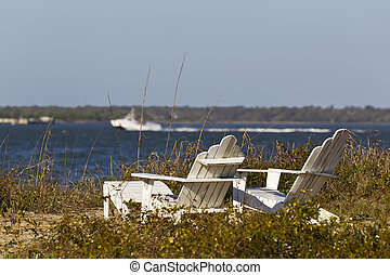 Adirondack Chairs - Adirondack chairs overlooking beach with...