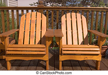 Adirondack Chairs - Adirondack chairs sitting on a backyard...