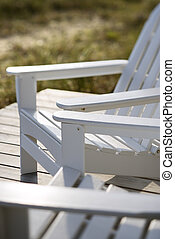 Adirondack chairs at beach. - Close-up of Adirondack chairs...