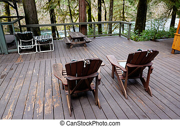 Adirondack Chairs on Deck and Screen Room - Screen room at a...
