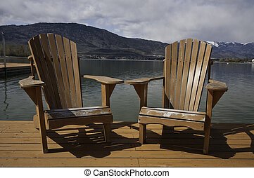 Adirondack chairs - Two adirondack chairs on the dock.