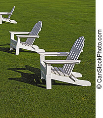 Adirondack Chairs - White Adirondack chairs on lawn.