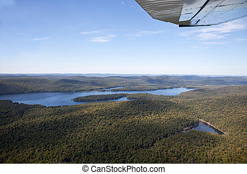 Adirondack forests and lakes summer aerial view from light aircr