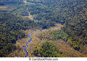 Adirondack forests, lakes, creeks and mountains aerial terrain view from light aircraft