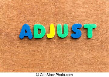 adjust colorful word on the wooden background