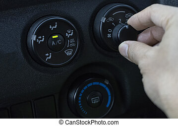 Adjust the air conditioner in the car