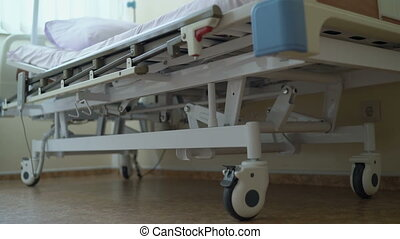 Adjustable electric hospital bed in a patient room