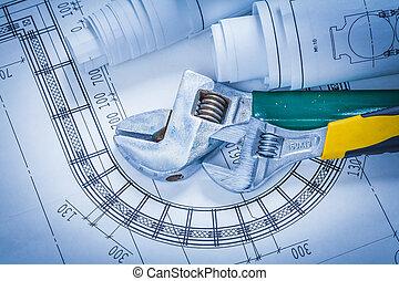 Adjustable spanners and construction blueprints maintenance conc