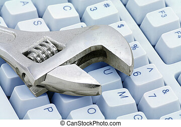 Adjustable Wrench and keyboard, concept of computer repairing