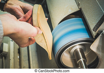 Adjusting an Orthotics Sole by Sanding it