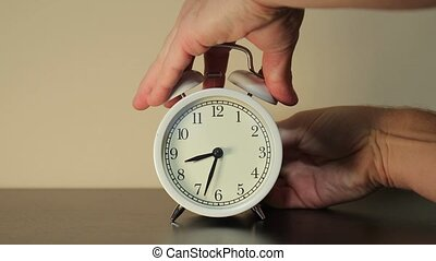 Setting clock back by one hour for ending summer daylight saving time in the autumn in October