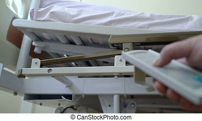 Adjusting hospital electric bed with remote control in a patient room