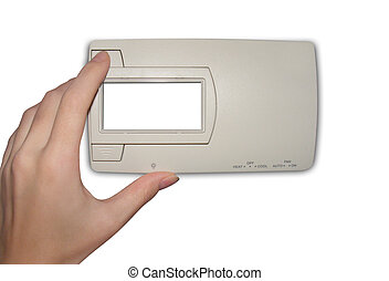 Adjusting Isolated Thermostat - A hand is adjusting a...