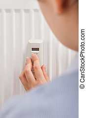 Adjusting Temperature With Digital Thermostat - Photo Of A...