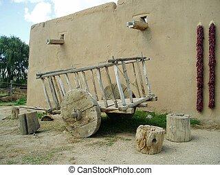 adobe hacienda - Old cart outside La Hacienda de los...