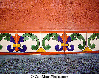 Adobe wall with color tile