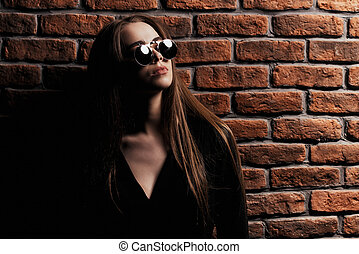 adolescence transition problems - Modern teen girl posing by...