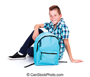 Adolescent Boy - Happy schoolboy sitting and smiling with...