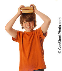 adolescent boy with school books resting on his head
