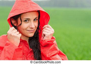 Adolescent girl in the rain in cloak