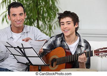 adolescent, jongen, leren, om te spelen, de, gitaar