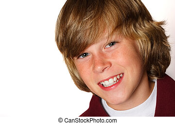 Adolescent - Teenaged boy smiling at the camera