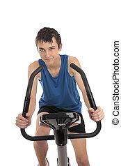 adolescente, condicão física, menino, bicicleta exercício, usando