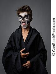 adolescente, cráneo, actuación, capa, negro, maquillaje, lengua