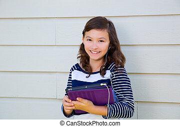 adolescente, heureux, tenue, pc tablette, et, earbuds
