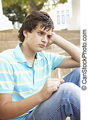 adolescente, sentado, infeliz, exterior, estudiante ...