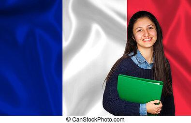 adolescente, sobre, bandeira francesa, estudante, sorrindo