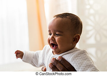 adorable african american baby boy indoors