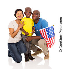 african american family of three with usa flag