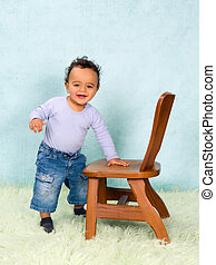 African baby boy trying to stand