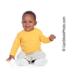 Adorable african baby sitting on the floor