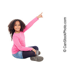 Adorable african little girl indicating something with her finge