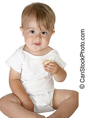Adorable Baby Boy Eating - Adorable baby boy sitting up...